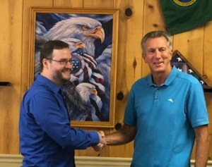 Image of author and Mayor shaking hands after appointment.
