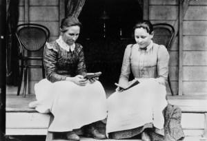 VINTAGE WOMEN SITTING ON PORCH