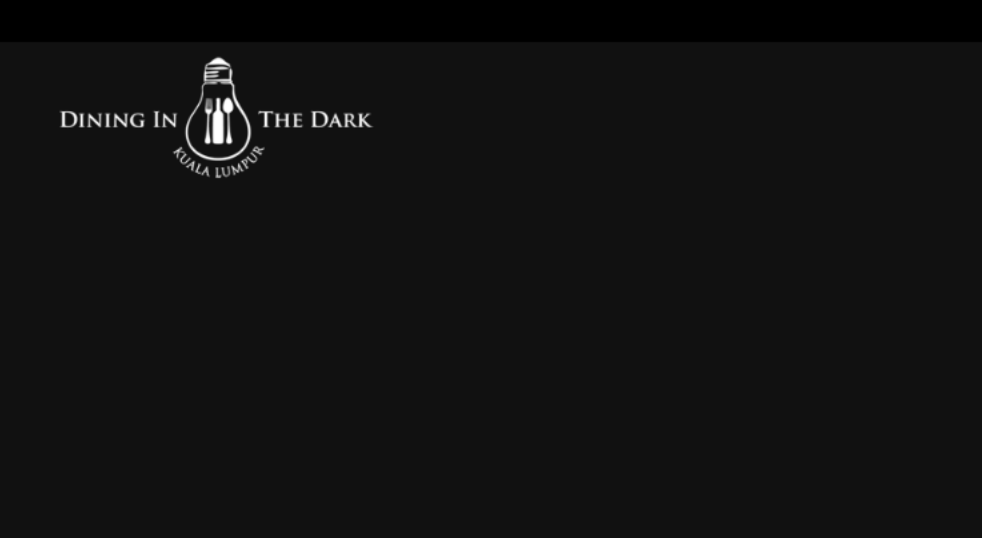 Logo of Dining in the Dark on a black background