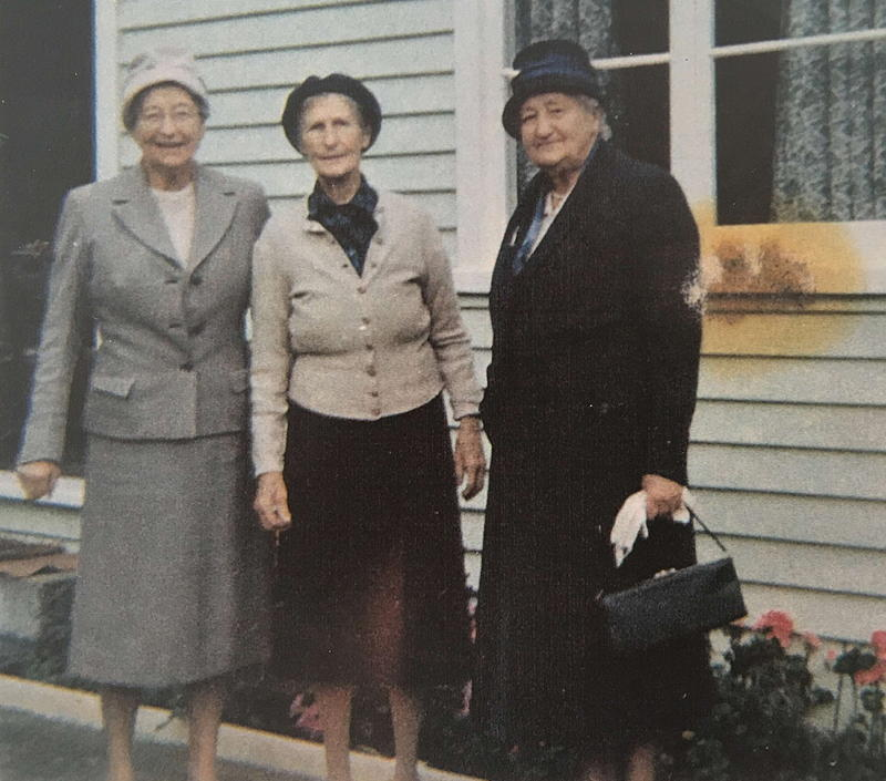 Photo of three middle-aged women in the 1950s
