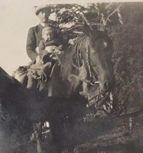 Rev. David Taylor on horseback with toddler in front.