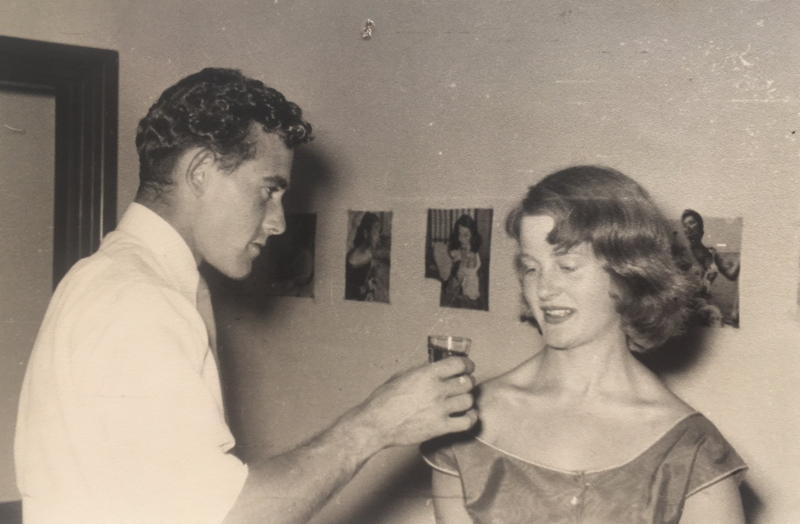 Sepia photo of 21 year old youth offtering a sherry to a 16 year old girl in party dress