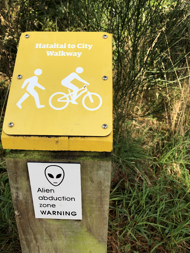 Notice in a park: Hataitai to City Walkway. Alien abduction zone WARNING