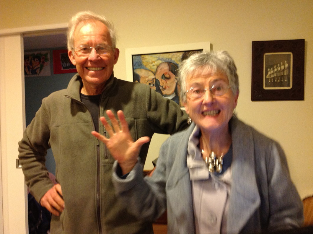 Two happy and lively old people, the woman waving.