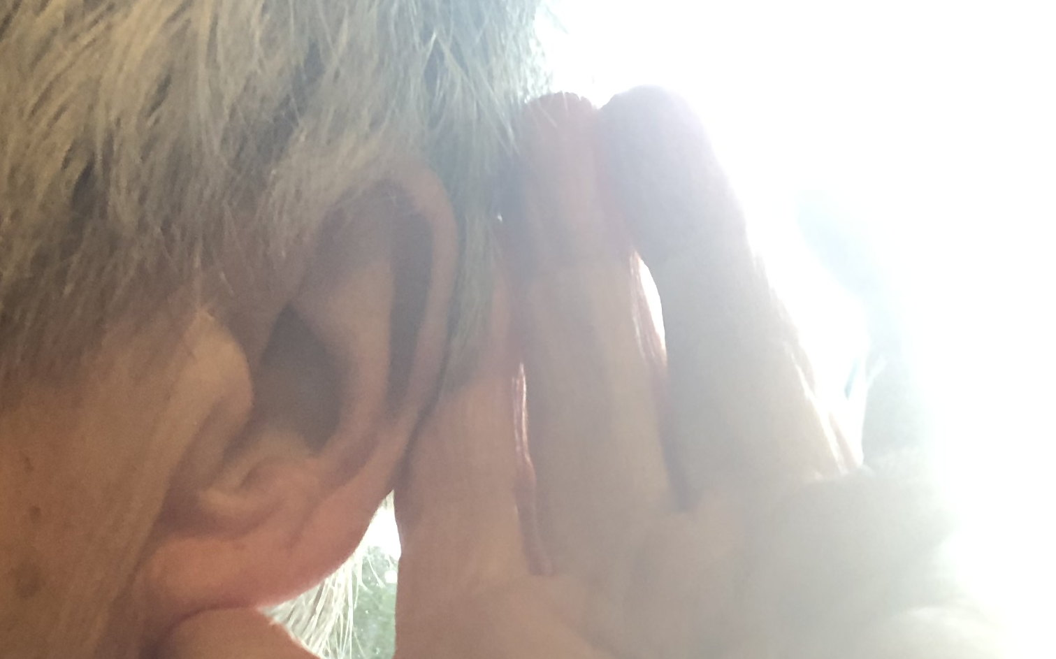 listening: photo of an ear cupped by a hand