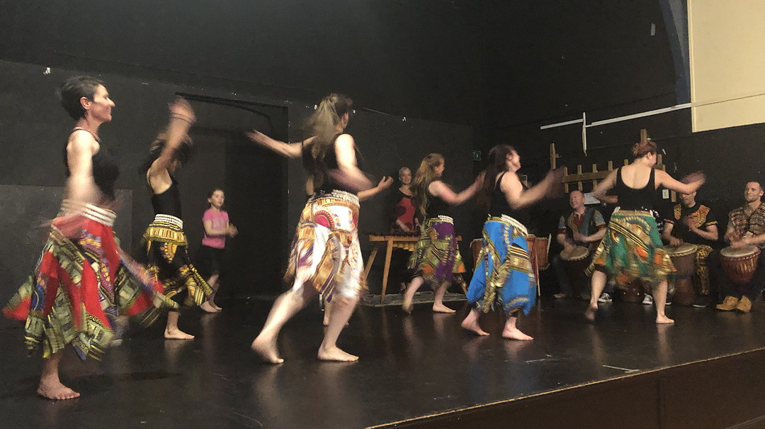 Photo of New Zealanders doing African dancing and drummers