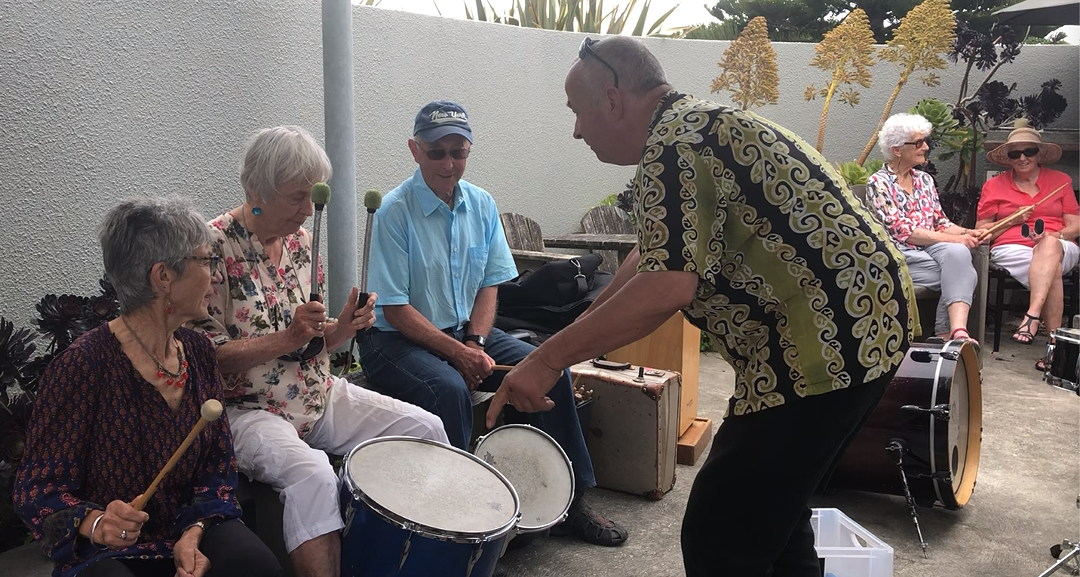 Percussionist Andreas Lepper teaching older people to drum