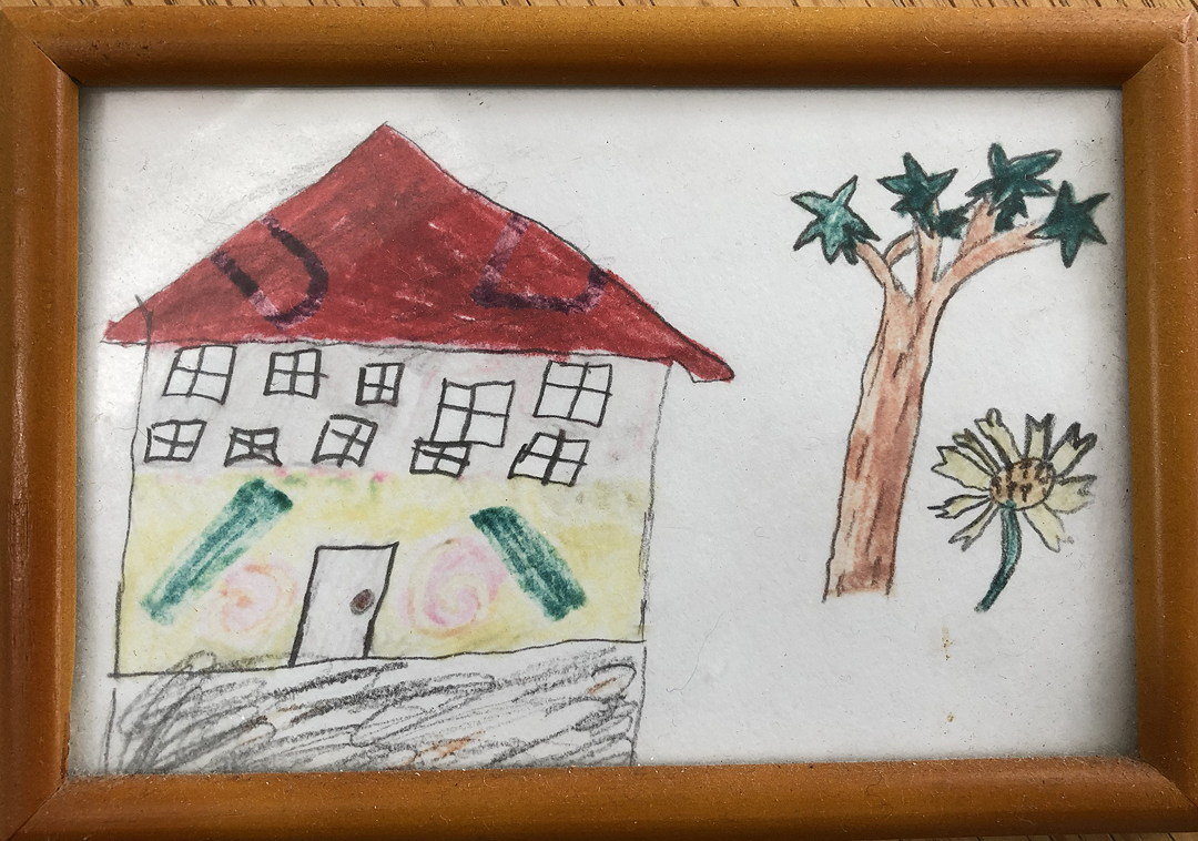 child's drawing of a house and tree and flower
