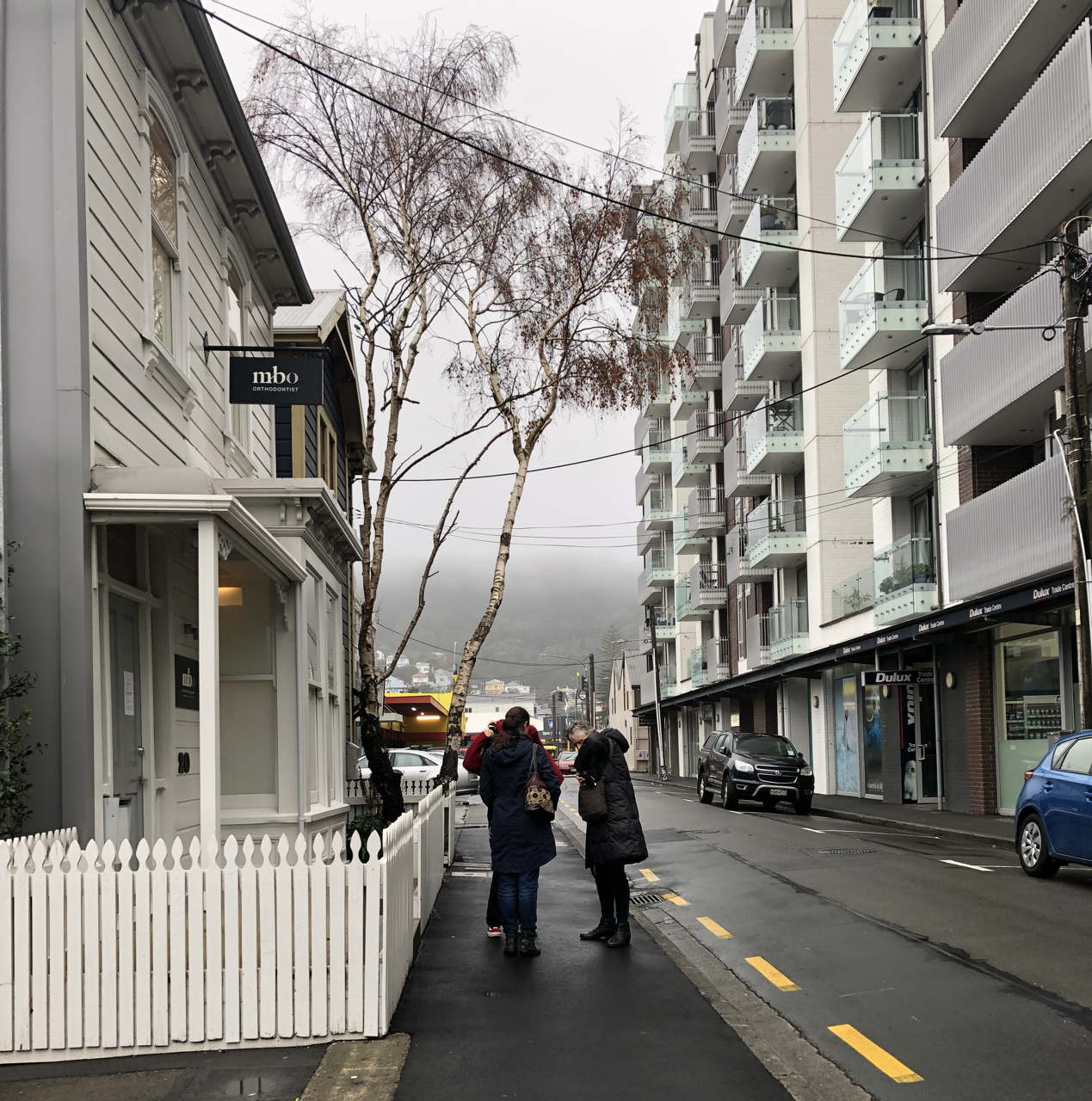 City street on a foggy grey day, people in winter coats