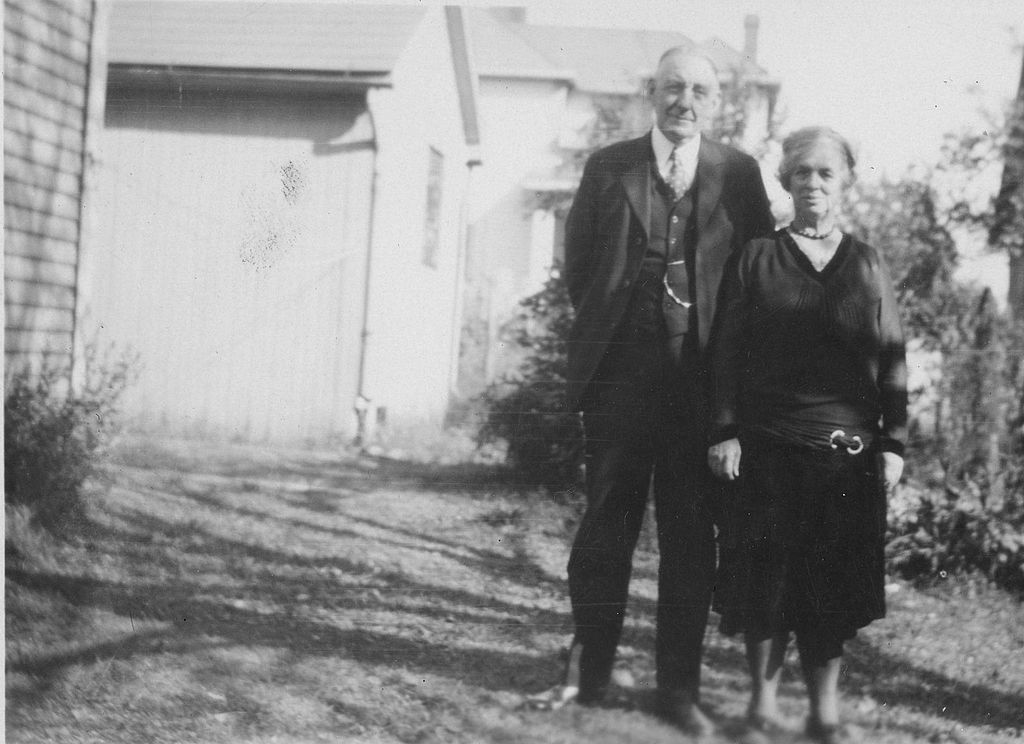 Black and white portrait of old couple in home garden