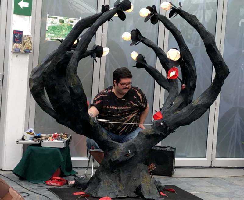 Musician Joel Vinsen playing the Harmonic Tree, a sculptural musical instrument