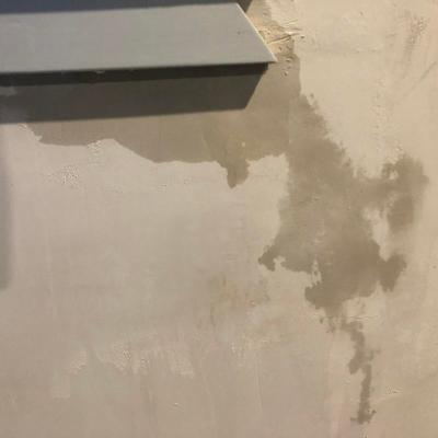 Photo of a windowsill with wet stain on fresh plaster