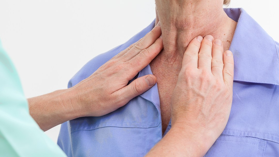 The thyroid gland on the neck