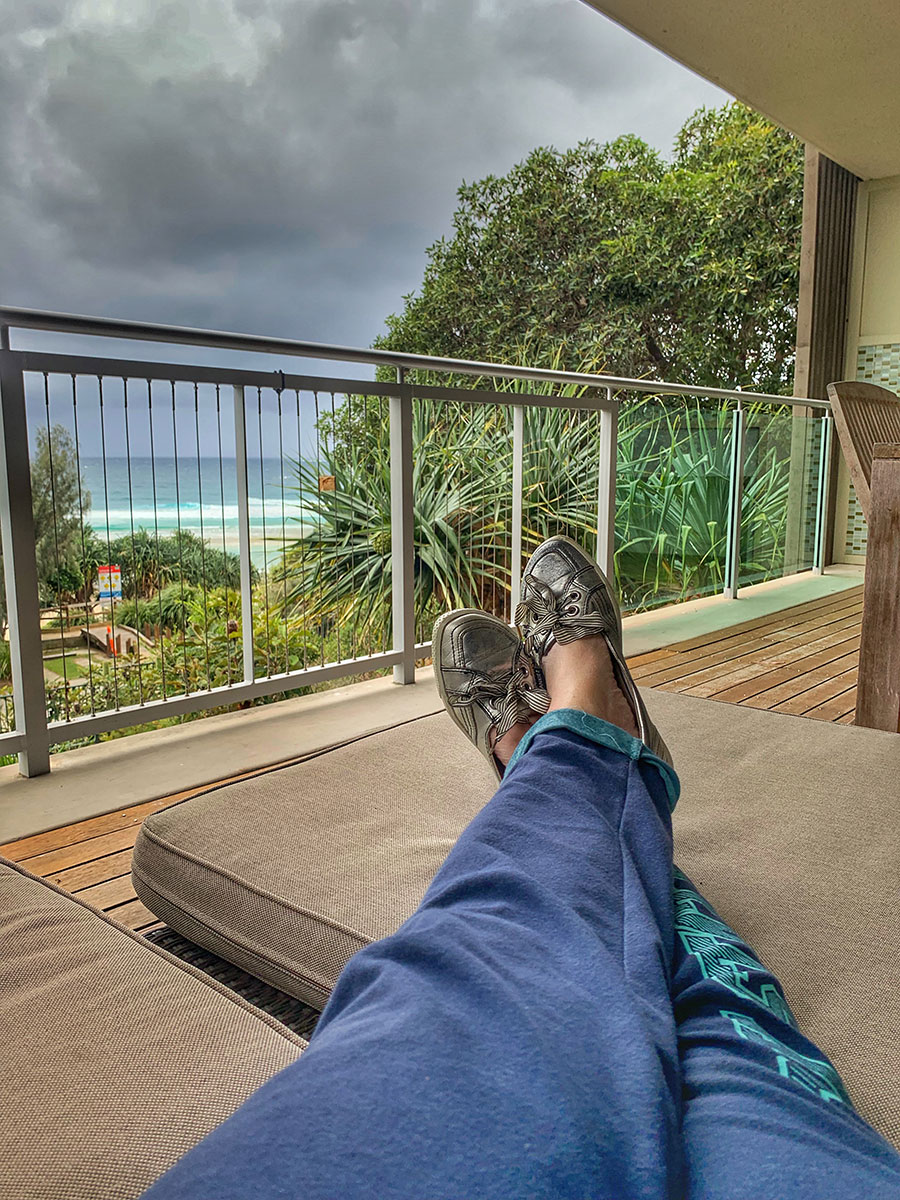 Relaxing on the deck of the apartment, North Stradbroke Island.