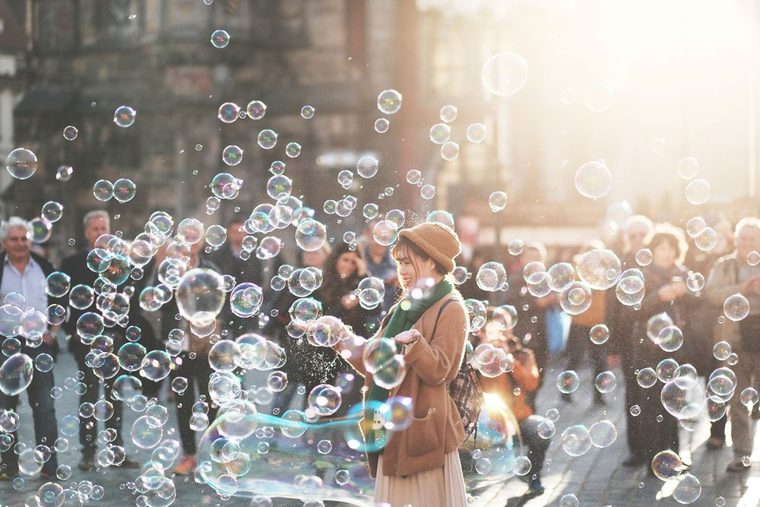 Woman in City with bubbles