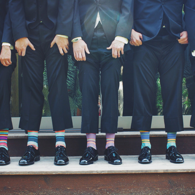 Group-of-Men Showing-Colorful-Socks-CC0