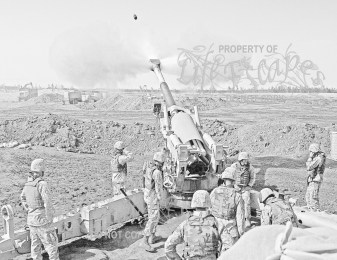 The US Marine Corps (USMC) M-198 155mm Howitzer gun crew of 4th Battalion, 14th Marines, Mike Battery, Gun 4, left to Right, Gunnery Sergeant (GYSGT) Justin Grafton, Cannoneer Private First Class (PFC) Matthew Camp, Section Chief Sergeant (SGT) Mike Dasher, Cannoneer Lance Corporal (LCPL) Josh Rosenberger, Cannoneer Corporal (CPL) Will McGee, Ammunition Team Chief CPL Jonathan Layman and Cannoneer LCPL Jonathan Fox. Marines at Camp Fallujah, Iraq (IRQ), engage enemy targets in support of Operation IRAQI FREEDOM.