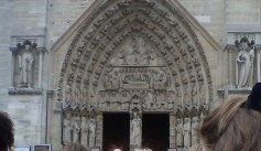 Doorway surrounded by statues of saints (beheaded saint 3rd from left)