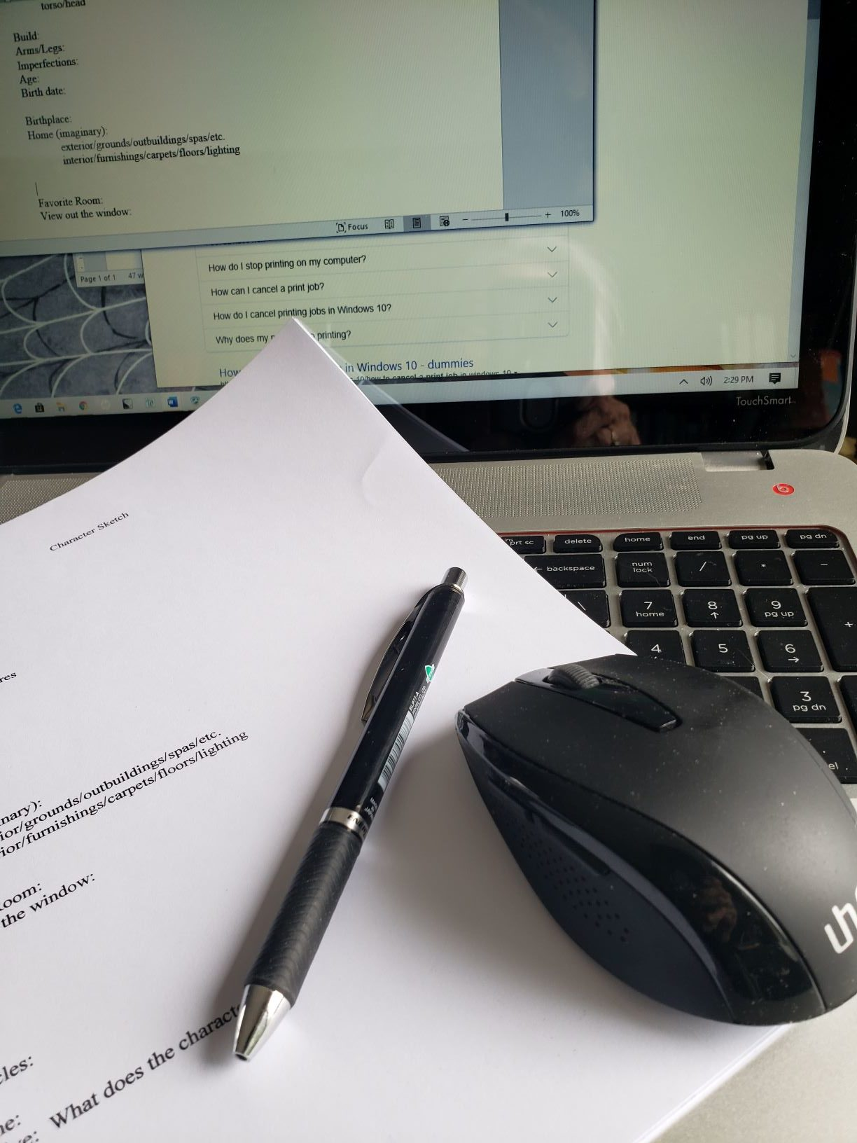 image of pen, paper, mouse and computer