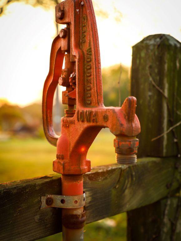 Photo by Frankie Lopez on Unsplash photo of an orange water pump