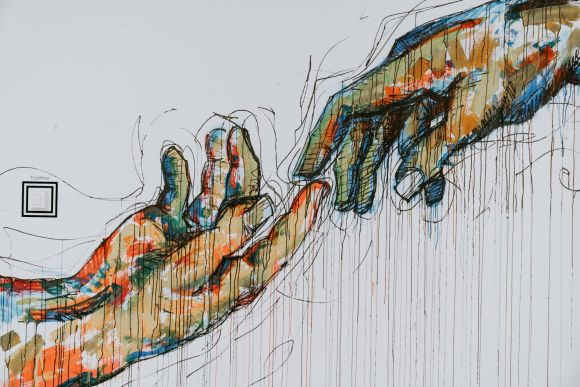 Touching Hands in Full Color Photo by Cytonn Photography on Unsplash
