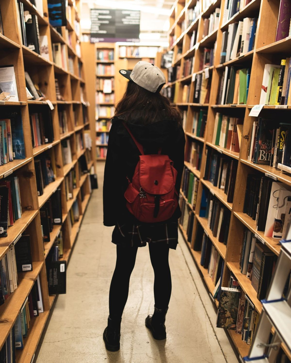 Woman in Bookstore Photo by Tyler Tang on Unsplash