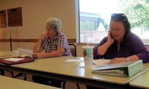 Susan Schmidlin and Karen Hess work on writing prompts during Writers in the Grove Monday Workshop.