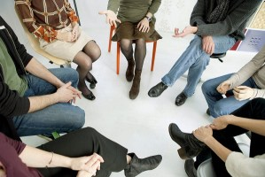 Group of people in a circle talking