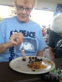 Ellen Atkins. On her plate: blueberries and peach cobbler.