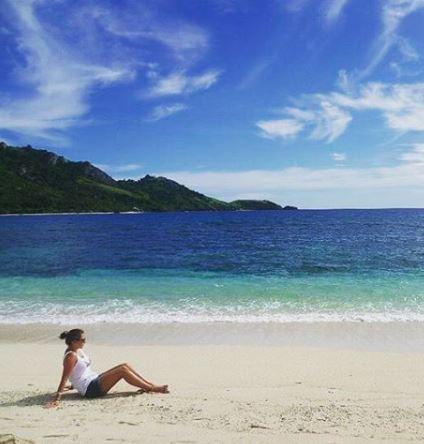 woman enjoying the sun on a beach