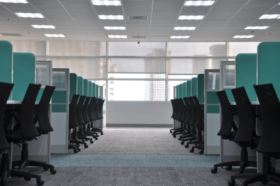 A row of grey cubicles