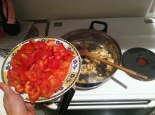 6. Sautee your garlic and onions and enjoy the wonderful smell. Up next, add tomatoes and cook for 3-5 minutes.