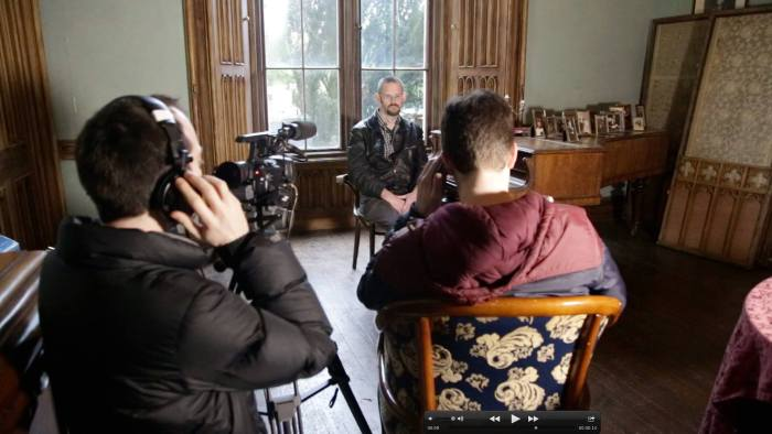 Behind the scenes still of me reading Out of Tune in Charleville Castle