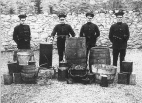 """Police with a siezed still in Inisowen - dad and Willie Carty used to run one in sheds while leaving a ribbish worm and paraphanalia in a field to be """"found"""" by customs men, and a few bottles for themselves to keep them quiet!"""