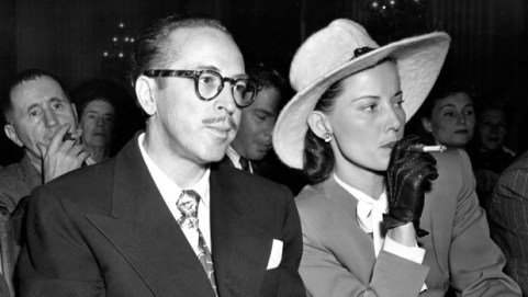 The real-life Dalton Trumbo, left, and his wife, Cleo, are seen in a 1947 file photo.
