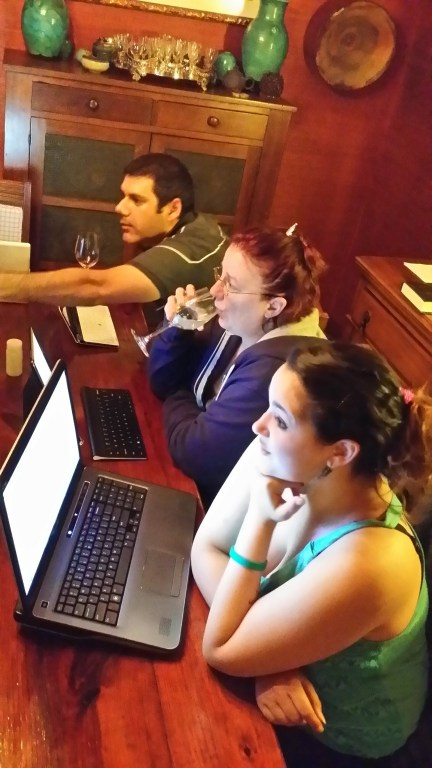 WtO Retreat: three students Hard at Work at the table in the dining room