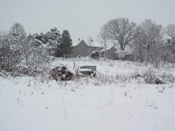 cozy farmhouse on a winter's morning