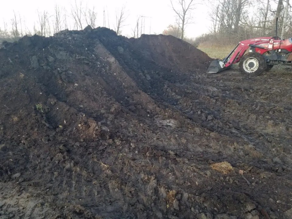 Large pile of compost on our pasture raised chicken farm.  Compost is a critical part of regenerative, organic farming.