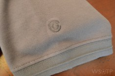 The embroidered Campo logo above the ribbed sleeve cuff.