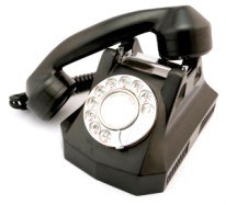 Image of a black rotary telephone with the handset partially off the hook.