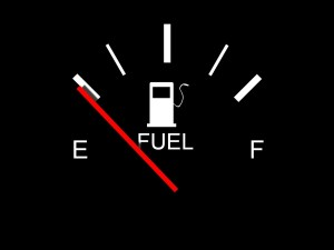 Image of fuel gauge with needle reading empty.
