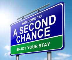 """Image of a road sign that reads """"Welcome to A Second Chance; Enjoy Your Stay""""."""