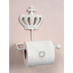 Image of toilet paper on a holder featuring a crown.