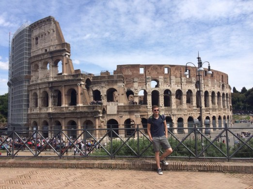 Tim, an adventurer, outside the Coloseum, Roma.