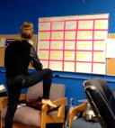 We love doing layout for the Buzzworthy. Allie poses by the board in the station.