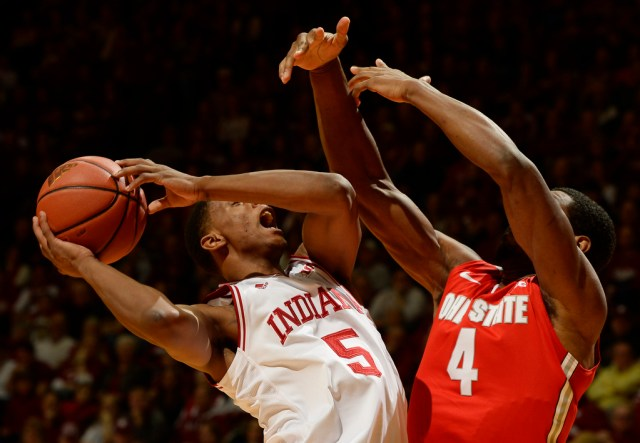 Chris Howell | Herald-Times Indiana Hoosiers forward Troy Williams (5) drives against Ohio State Buckeyes center Daniel Giddens (4) during the Indiana Ohio State men's basketball game at Assembly Hall in Bloomington, Ind. January 10, 2016.