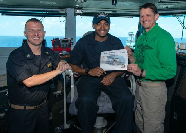 160723-N-MY174-044  PACIFIC OCEAN (July 23, 2016) Yeoman 3rd Class Justin Hewitt, from Louisville, Kentucky, receives the Sailor of the Day award from Capt. Greg Huffman, USS John C. Stennis' (CVN 74) commanding officer, and Command Master Chief Benjamin Rushing. Providing a combat-ready force to protect collective maritime interests, John C. Stennis is operating as part of the Great Green Fleet on a regularly scheduled Western Pacific deployment. (U.S. Navy photo by Mass Communication Specialist 3rd Class Tomas Compian/ Released)