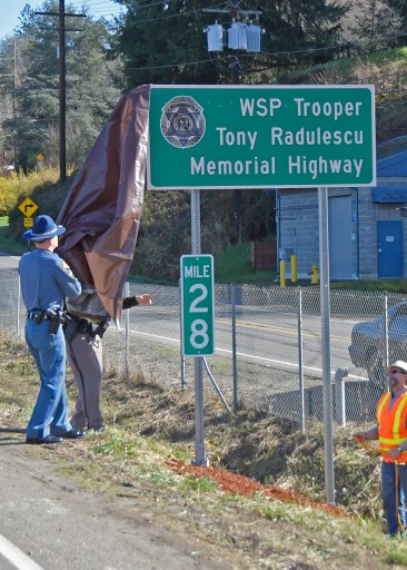 Trooper Tony Radulescu Highway Renaming Ceremony. Chief John Batiste and Governor Jay Inslee unveil sign dedicating Hwy16 as the Trooper Tony Radulescu Memorial Highway Sign