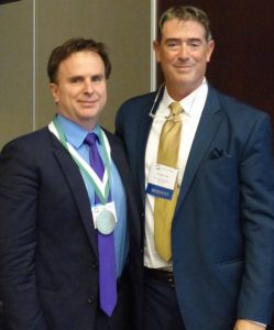 WSRS President, Dr. Eric Stern (right) congratulates Dr. Norman Beauchamp, 2016 WSRS Gold Medal Award recipient.