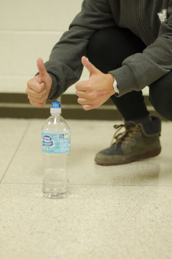 behind the water bottle